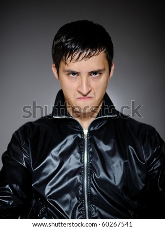 Expressions. Young aggressive leader man - stock photo