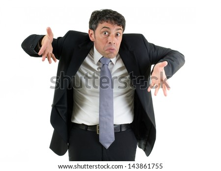 Expressive businessman shrugging his shoulders in ignorance or indifference and gesturing with his hands isolated on white - stock photo