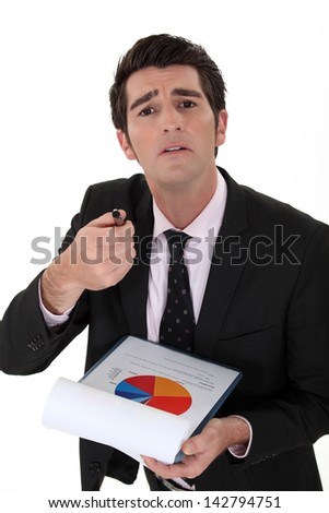 Expressive businessman with graph - stock photo