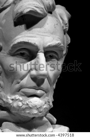 expressive close-up portrait of abraham lincoln statue at the lincoln memorial in washington dc - stock photo