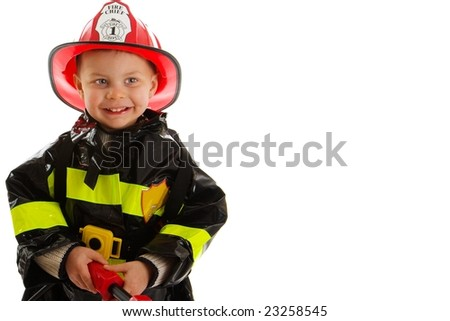 Expressive cute toddler with fireman's outfit on - stock photo