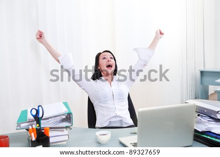 Expressive employee shouting happily in office