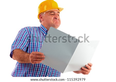 expressive engineer looking at plans isolated on white - stock photo