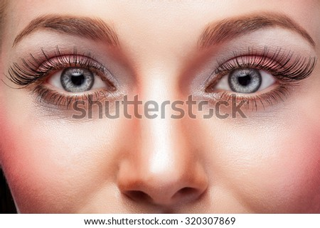 Expressive eyes with make up and big eyelashes. Studio shooting. Beauty face. Advertising for make up - stock photo
