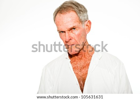 Expressive good looking senior man casual summer dressed against white wall. Spiritual and characteristic. Isolated. Studio shot.