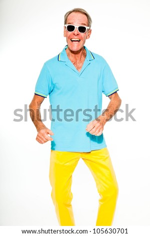 Expressive good looking senior man casual summer dressed against white wall. Wearing sunglasses. Happy, funny and characteristic. Isolated. Studio shot. - stock photo