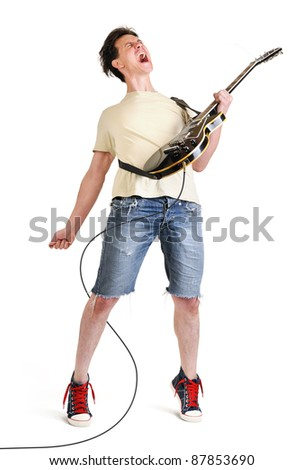 Expressive guitarist playing his electric guitar on white background