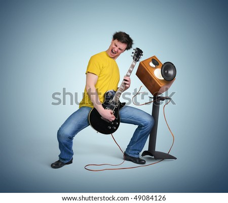 Expressive guitarist with exploding speaker, art concept music