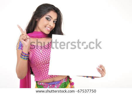 Expressive Indian Girl Holding Blank Card - stock photo
