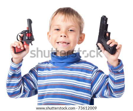 expressive little boy with two guns - stock photo