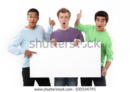 Expressive men holding a white sign for message - stock photo
