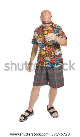 Expressive old man in loud shirt holiday concept isolated against white. - stock photo