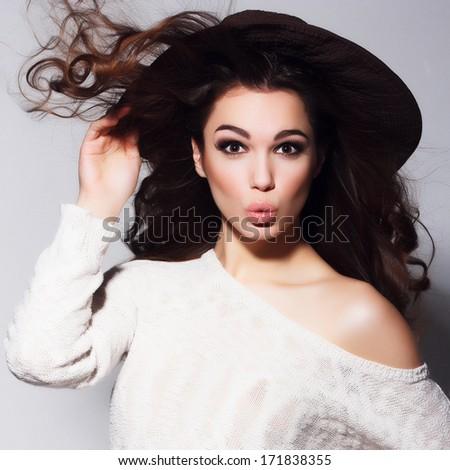 Expressive portrait of a beautiful brunette girl in the studio - stock photo