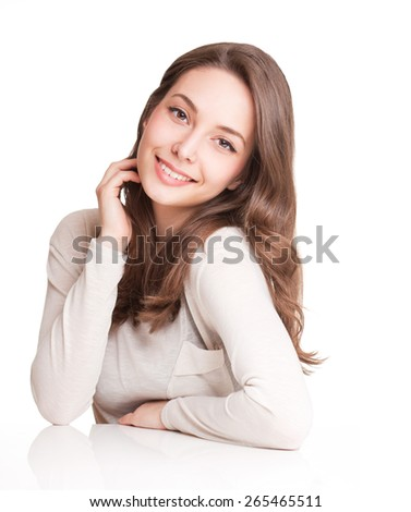 Expressive portrait of a friendly gorgeous young brunette. - stock photo