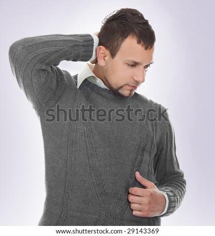 expressive portrait of Man who has neck pain - stock photo