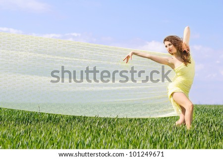 Expressive pretty girl in a green field