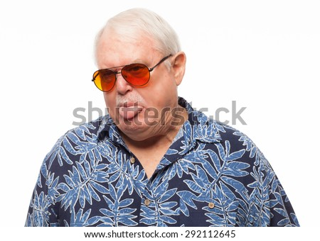 Expressive retired senior man wearing loud hawaiian shirt giving silly expression on white background. - stock photo