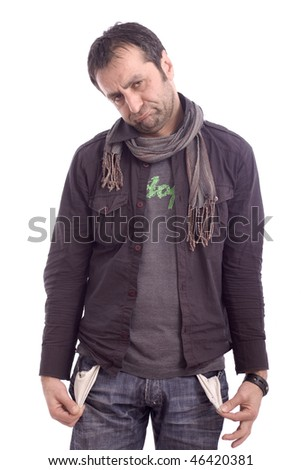 Expressive sad looking man showing his empty pockets isolated over white background - stock photo