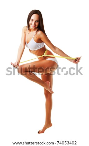 Expressive sporty slim woman with measure on white background - stock photo