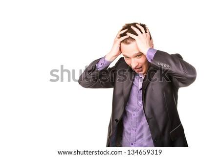 Expressive young businessman frustated thinking isolated on white - stock photo