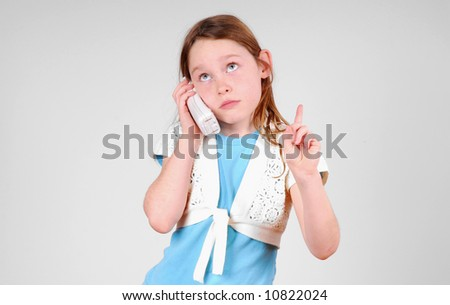 Expressive young girl on phone holding up finger