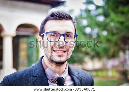 Expressive young man portrait outdoor - stock photo