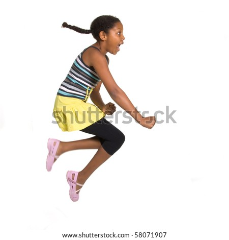 Expressive Young Mixed Race Girl leaping and jumping isolated against white background.