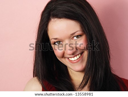 expressive young woman portrait with red background