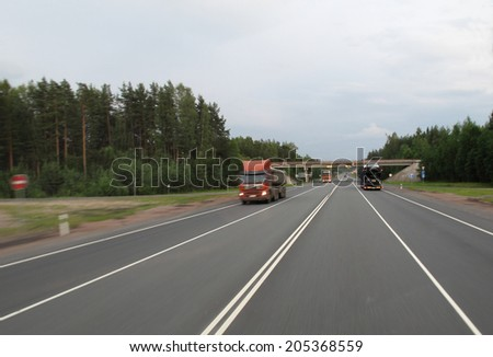 expressway in cloudy  twilight - stock photo
