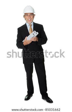 Exprienced engineer holding some building plans - stock photo