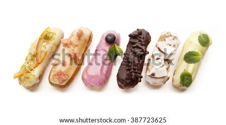 exquisite cream dessert eclairs on a white background - stock photo