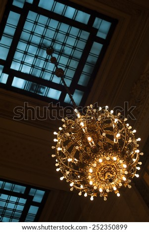 Exquisite lamp inside Grand Central Terminal, NYC - stock photo