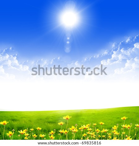 Exquisite landscape with blue skies, sunshine and green grass - stock photo
