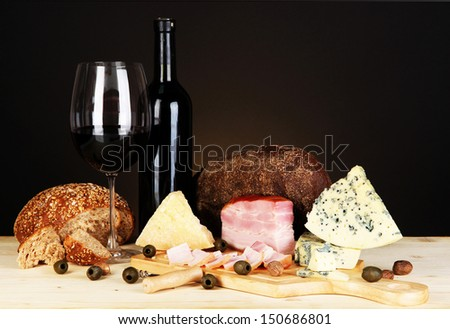Exquisite still life of wine, cheese and meat products