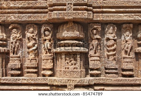 Exquisitely carved beautiful sculptures at Sun Temple, Konark - stock photo