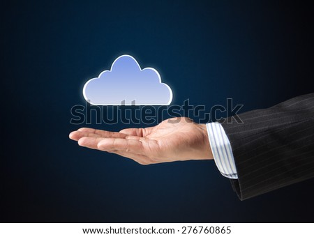 Extended arm of a businessman with a cloud icon floating. Concept image for cloud computing technologies