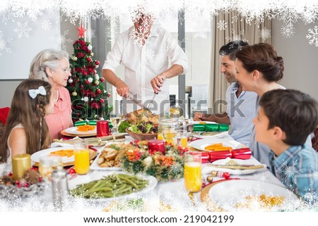 Extended family at dining table for christmas dinner in house against fir tree forest and snowflakes