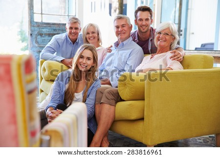 Extended Family Group At Home Relaxing In Lounge - stock photo