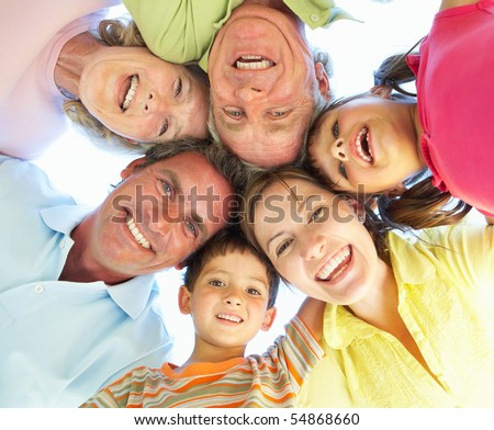Extended Family Group Looking Down Into Camera - stock photo