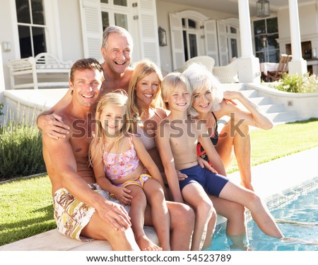 Extended Family Outside Relaxing By Swimming Pool - stock photo