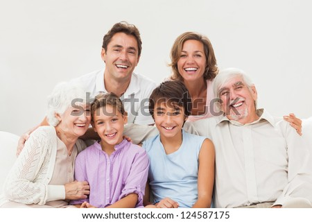 Extended family portrait on the couch - stock photo