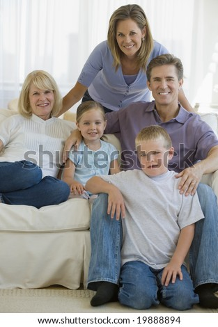 Extended family portrait sitting on a couch - stock photo