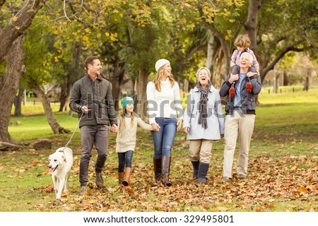 Extended family posing with warm clothes on an autumns day - stock photo
