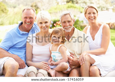 Extended Family Relaxing In Garden - stock photo