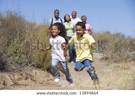 Extended Family walking in countryside - stock photo
