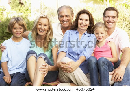 Extended Group Portrait Of Family In Garden - stock photo
