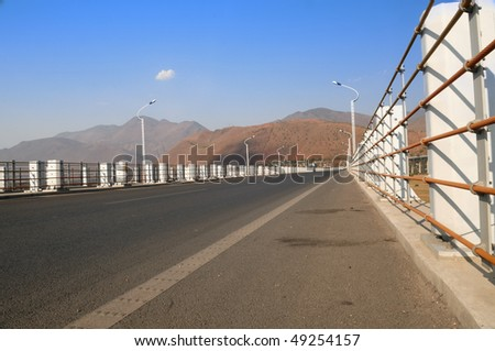 Extension bridge and road on blue sky. - stock photo