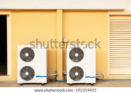 Exterior  Air Conditioner Fan on the yellow wall