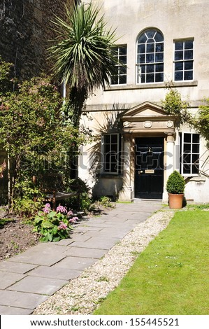 Exterior and Garden of a Beautiful Georgian Era English Town House - stock photo