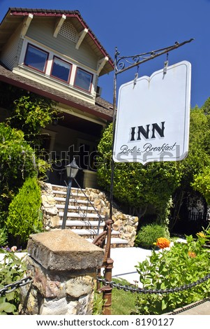 Exterior and sign of a quaint bed and breakfast inn - stock photo